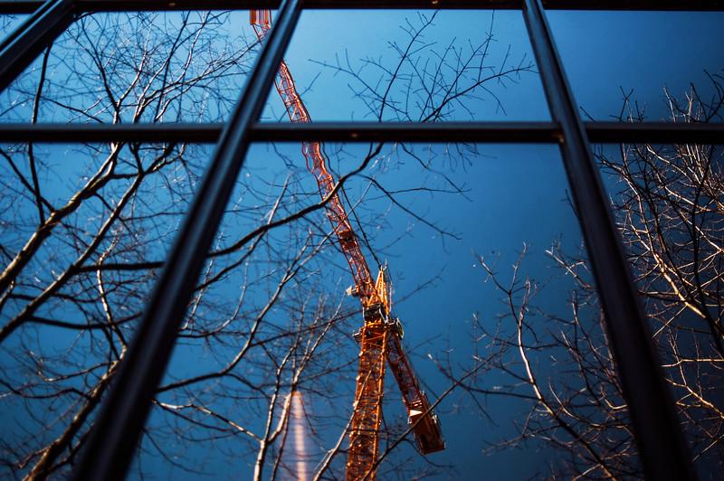 crane reflecting building window seattle.jpg
