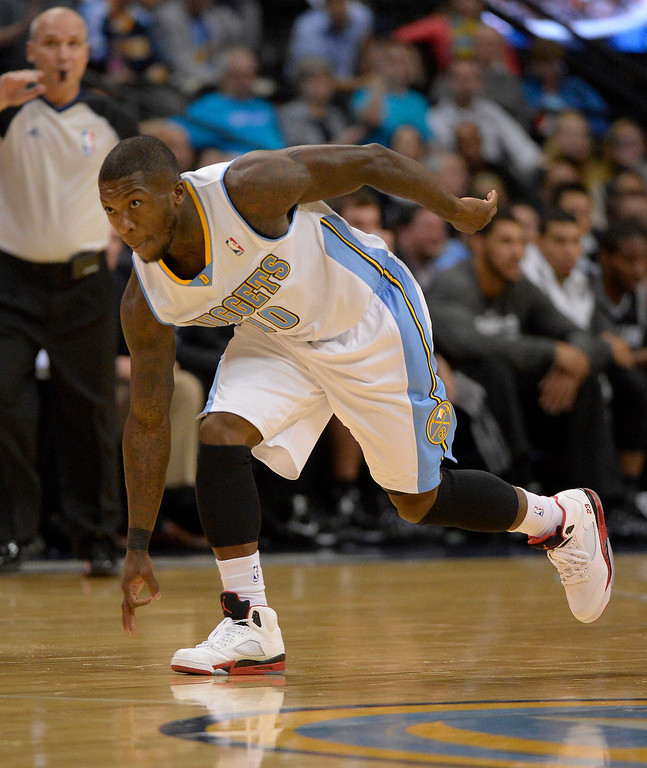 . Denver Nuggets point guard Nate Robinson (10) signals his three point shot during the first quarter against the San Antonio Spurs October 14, 2013 at Pepsi Center. (Photo By John Leyba/The Denver Post)