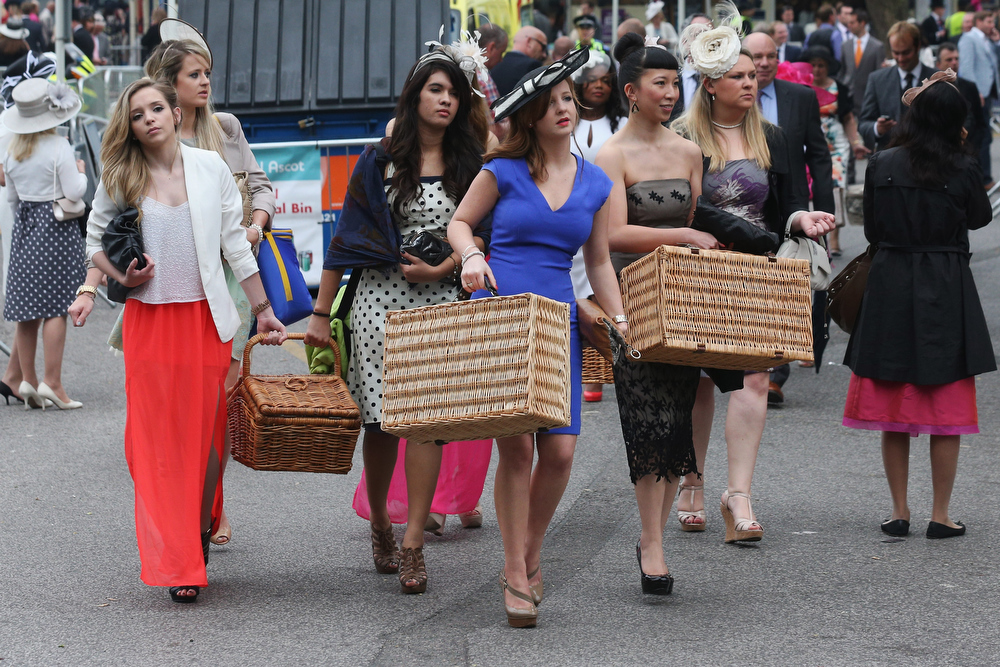 . Racegoers carry hampers to Ascot racecourse to attend Royal Ascot on June 20, 2013 in Ascot, England. The \'Royal Ascot\' horse race meeting runs from June 18, 2013 until June 22, 2013 and has taken place since 1711. The racecourse is expected to welcome around 280,000 racegoers over the five days, including Her Majesty The Queen and other members of the Royal Family.  (Photo by Oli Scarff/Getty Images)
