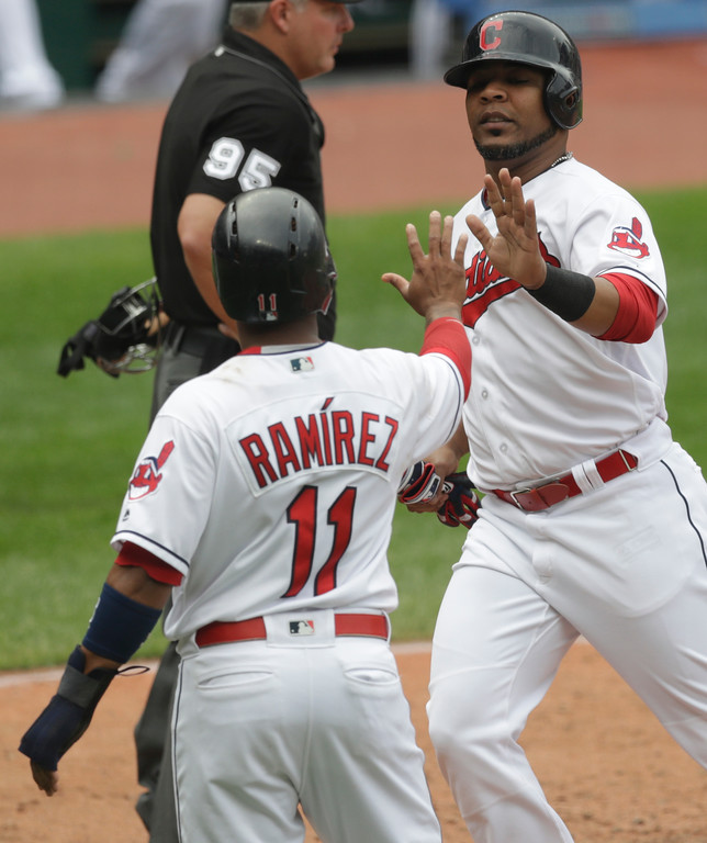 . Cleveland Indians\' Edwin Encarnacion, right, is congratulated by Jose Ramirez after both scored on Melky Cabrera\'s two-run double in the third inning of a baseball game, Wednesday, May 30, 2018, in Cleveland. (AP Photo/Tony Dejak)
