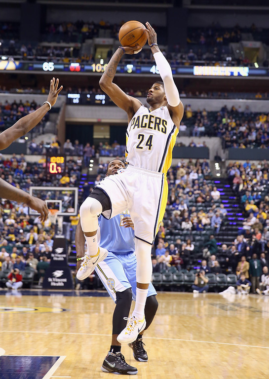 . Paul George #24 of the Indiana Pacers shoots the ball during the game against the Denver Nuggets at Bankers Life Fieldhouse on February 10, 2014 in Indianapolis, Indiana.  (Photo by Andy Lyons/Getty Images)