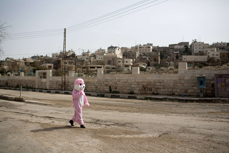 . An Israeli settler dressed up in an animal outfit takes part in a parade to celebrate the Jewish holiday of Purim in al-Shuhada Street, in the West Bank town of Hebron, on March 16, 2014. The carnival-like Purim holiday is celebrated with parades and costume parties to commemorate the deliverance of the Jewish people from a plot to exterminate them in the ancient Persian Empire 2,500 years ago, as recorded in the Biblical Book of Esther. (MENAHEM KAHANA/AFP/Getty Images)