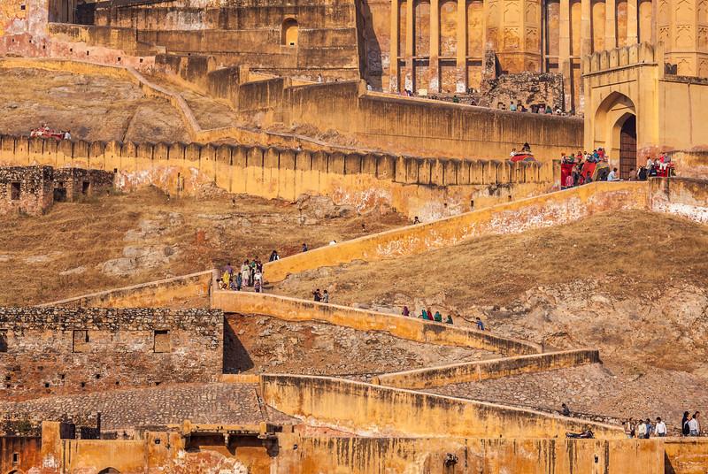 Visitors ascending to Amer (Amber) fort. Amer (near Jaipur), Rajasthan, India