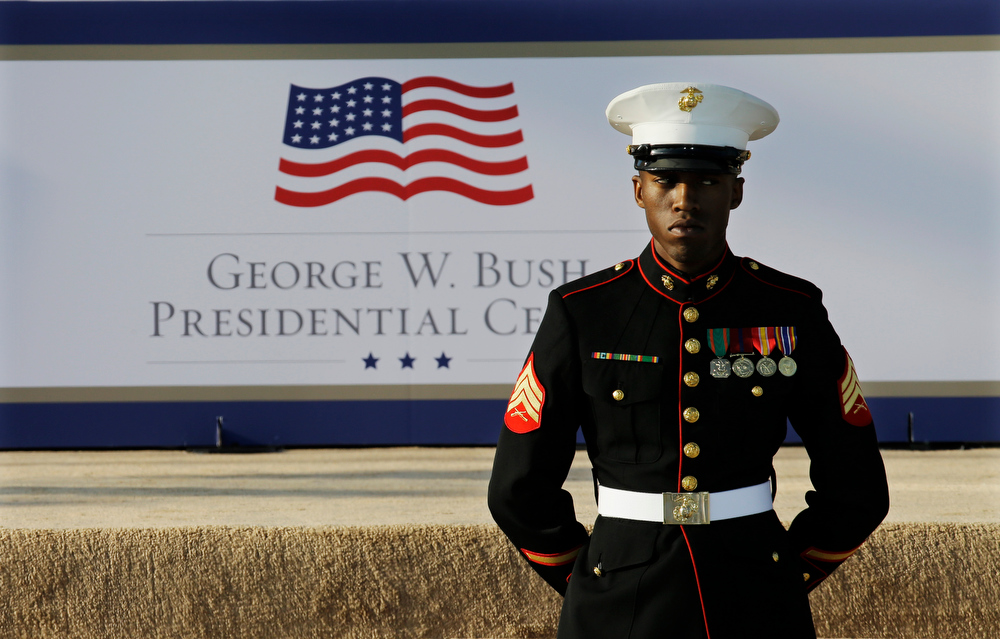 Description of . A marine waits for the arrival of guests before the dedication of the George W. Bush Presidential Center Thursday, April 25, 2013, in Dallas. The ceremony will be attended by President Barack Obama and four former presidents. (AP Photo/David J. Phillip)