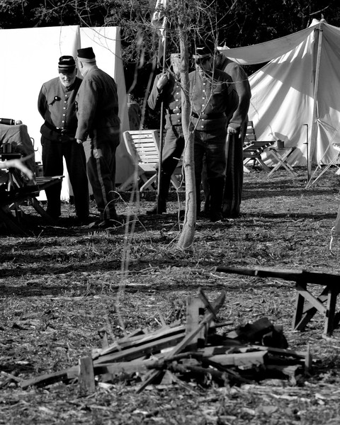 A group of artillery battery reenactors relax in their camp at the end of the day at Patriots Point in Mt. Pleasant, South Carolina on Sunday, April 10, 2011. ..The 150th Anniversary of the Firing on Ft. Sumter was commemorated with lectures, performances, demonstrations, and a living history throughout the area on James Island, Charleston, Mt. Pleasant, and Sullivan's Island during the week from April 8-14, 2011. Photo Copyright 2011 Jason Barnette