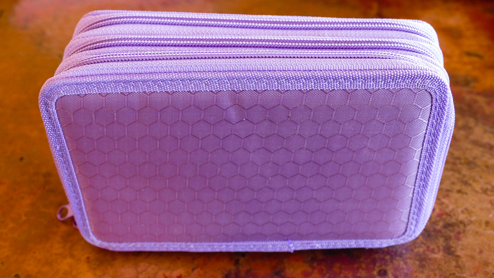 My purple pencil carrying case holds 72 pencils. I take it on longer trips.