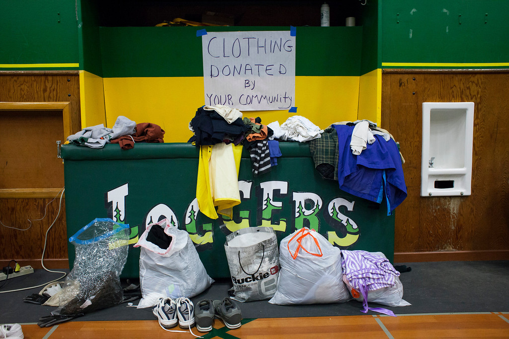 . Donations of clothing and shoes are pictured at a temporary Red Cross shelter at the Darrington Community Center in Darrington, Washington on Sunday, March 23, 2014.  (Photo by David Ryder/Getty Images)