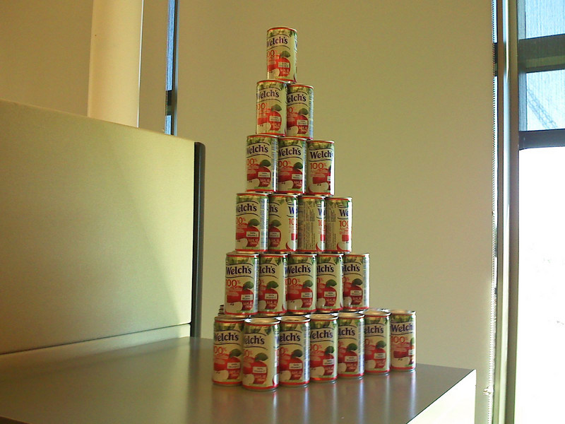 Zach's Apple Juice Pyramid  Zach collects apple juice cans and is slowly creating a large pyramid just outside his cube.
