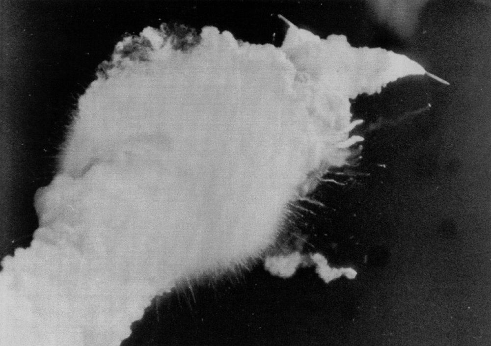 Description of . The two solid rocket boosters can be seen (Top Right) exploding away from the Shuttle Challenger shortly after blastoff 1/28 in the worst disaster in American space history.  Denver Post Library Archive
