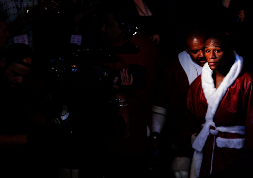 . Floyd Mayweather enters the ring before his fight against Zab Judah during the Welterweight Championship fight at Thomas & Mack Arena on April 8, 2006 in Las Vegas, Nevada.  (Photo by Al Bello/Getty Images)
