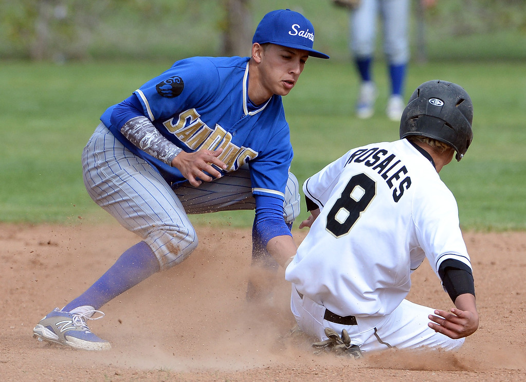 . San Dimas shortstop Josh Avila (C) tags out Northview\'s Ruben Rosales (8) on a attempted steal of second base in the second inning of a prep baseball game at Northview High School in Covina, Calif., on Wednesday, March 26, 2014. San Dimas won 2-0. (Keith Birmingham Pasadena Star-News)