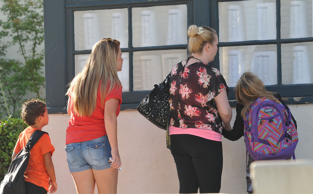 . (John Valenzuela/Staff Photographer) Mckinley Elementary students and parents check the classroom list, before the start of school, Weddnesday in Redlands, August 14, 2014.