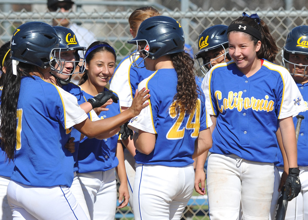 . California\'s Trisha Trujillo (#24) is congratulated by teammates after hitting a three-run homerun as they play Bell Gardens in their non-league game at California High School in Whittier on Thursday March 14, 2013. California beat Bell Gardens 10-0 in five innings. (SGVN/Staff Photo by Keith Durflinger)