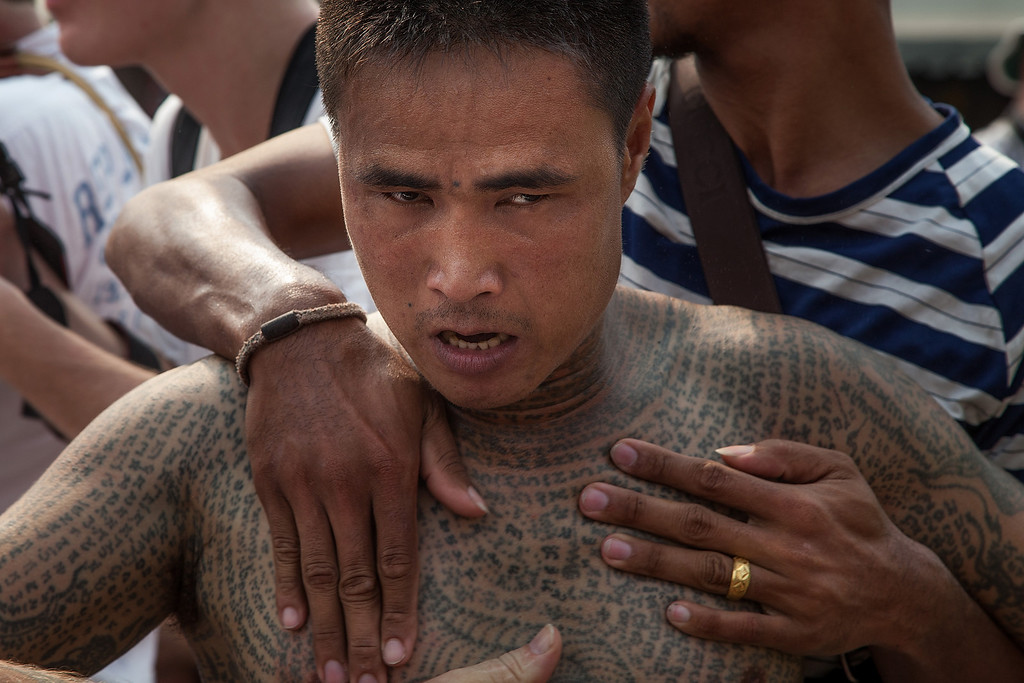 . A tattooed Thai devotee reportedly possessed by spirits is helped by volunteers during the celebration of the annual Tattoo festival at Wat Bang Phra on March 15, 2014 in Nakhon Pathom, Thailand.  (Photo by Omar Havana/Getty Images)