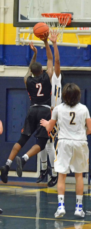 . Paul DiCicco - The News-Herald Orange�s Jordan Thompson drives to the hoop against Wickliffe late in the game.