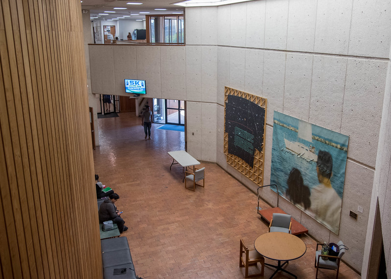 Students relax in The Center For Arts Lobby.