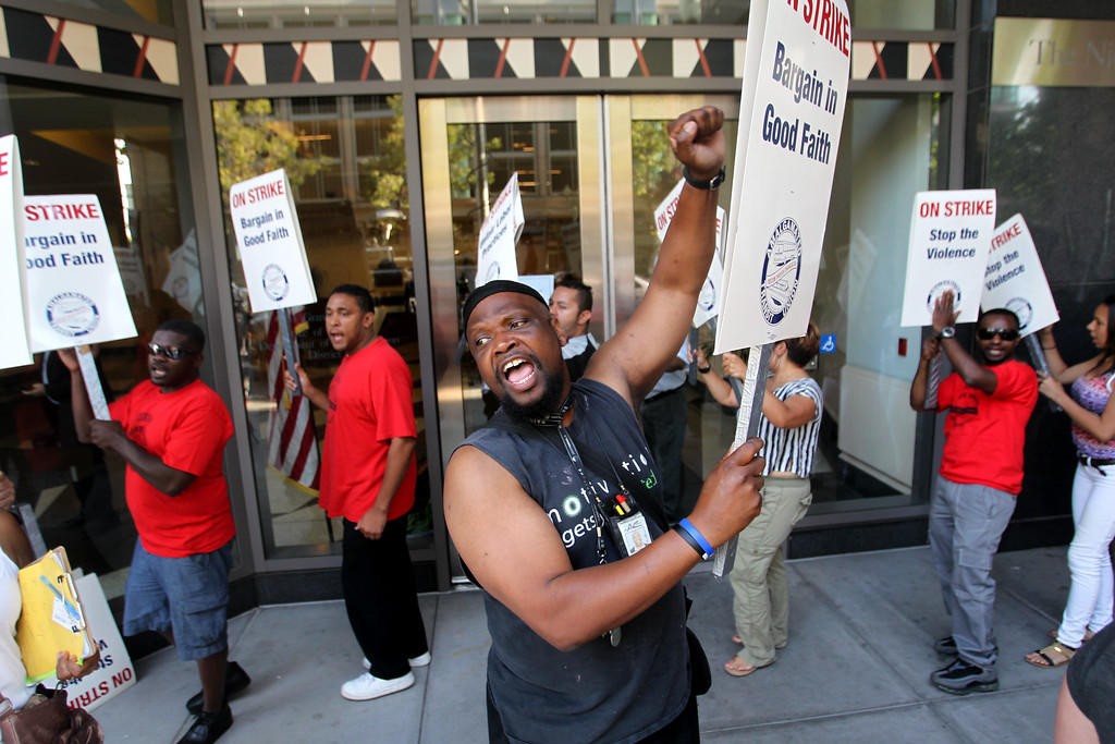 . Nathaniel Arnold, center, and fellow union members picket outside Caltrans building where BART administration and BART unions negotiate their contract on their third day of strike in Oakland, Calif., on Wednesday, July 3, 2013. (Ray Chavez/Bay Area News Group)