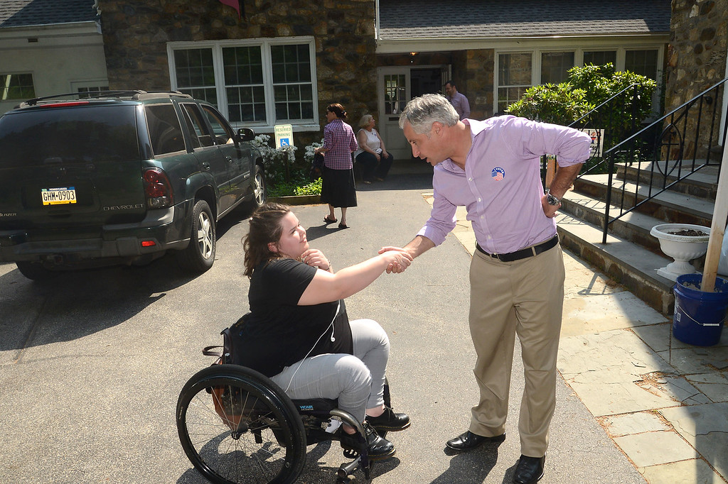 . PETE  BANNAN-DIGITAL FIRST MEDIA       Sean Farhy  greets voter, Elizabeth Clodfelter outside Radnor Methodist church. Voters had to use a separate machine to vote for the special commissioner election.