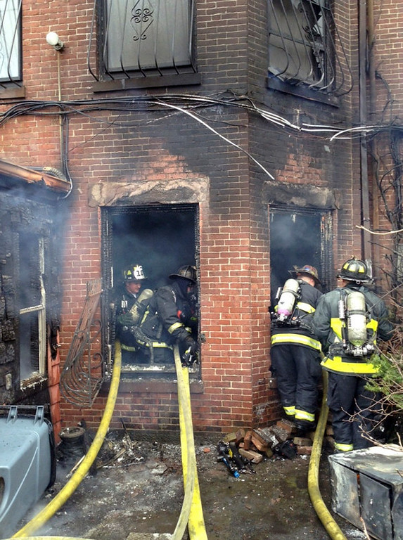. In this photo released by the Boston Fire Department via Twitter, firefighters battle a multi-alarm fire at a four-story brownstone in the Back Bay neighborhood near the Charles River Wednesday, March 26, 2014 in Boston.  (AP Photo/Boston Fire Department)