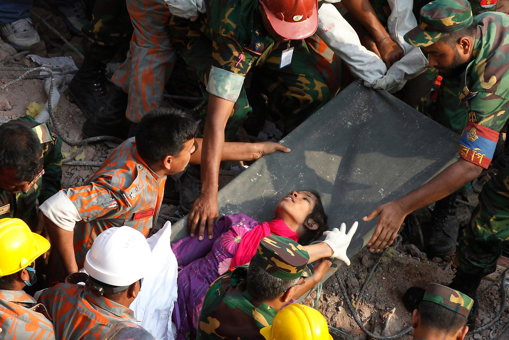 . Survivor Reshma Begum lies on a stretcher after being pulled out from the rubble of a building that collapsed in Savar, near Dhaka, Bangladesh, Friday, May 10, 2013. Begum was working in a factory on the second floor of Rana Plaza when the building began collapsing around her April 24. She raced down a stairwell into the basement, where she became trapped near a Muslim prayer room in a wide pocket that allowed her to survive, she told the private Somoy TV. (AP Photo)