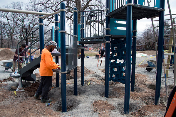 03/10/20 Wesley Bunnell | StaffrrEmployees from LHI ,based in Orange, CT install new playground equipment on Tuesday March 20, 2020 at Stanley Quarter Park. The park is undergoing a renovation of several areas. New cushioned play ground coverings will eventually be installed similar to the work installed by Lamar Johnson looks through for the right tools when putting the finishing touches on a set of stairs.