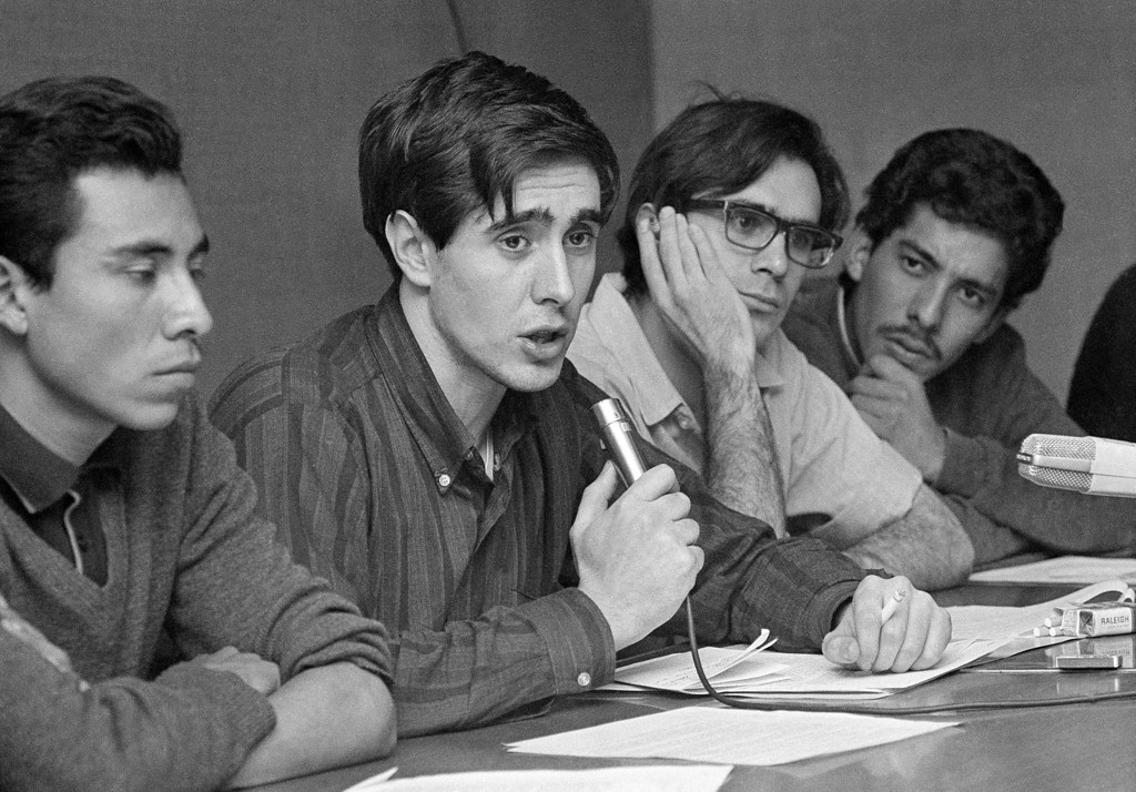 . Cesar Perello, a spokesman for the Mexico University students, gives a pledge of no more violence at a press conference in the auditorium of the University�s Medical Center in Mexico City, Oct. 5, 1968. With him are other leaders of the students� �strike committee�, Cesar Tirado, left, Roberto Escudero (with glasses) and Jose Nassar, right. (AP Photo)