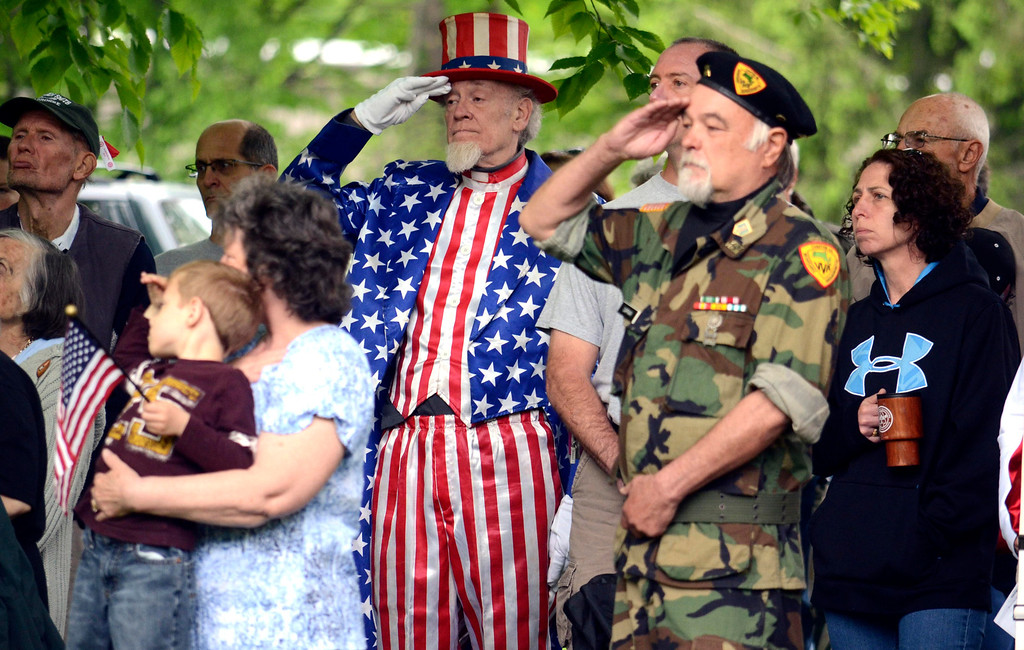 . Dressed as Uncle Sam, Gordon Dunn of Pittsfield, Mass., salutes fallen veterans at a memorial held in the town cemetery on Memorial Day in Pittsfield, Mass., Monday May 26, 2014. (AP Photo/The Berkshire Eagle, Ben Garver)