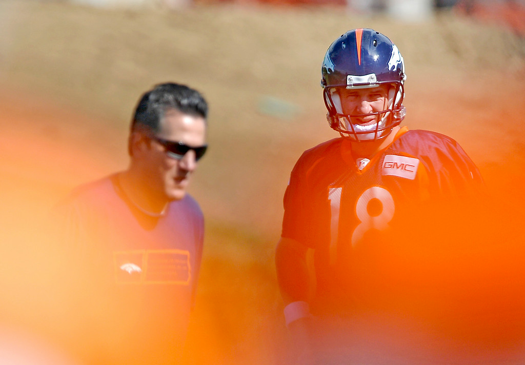 . Denver Broncos quarterback Peyton Manning (18) looks on during drills during the first day of the Denver Broncos 2014 training camp July 24, 2014 at Dove Valley. (Photo by John Leyba/The Denver Post)