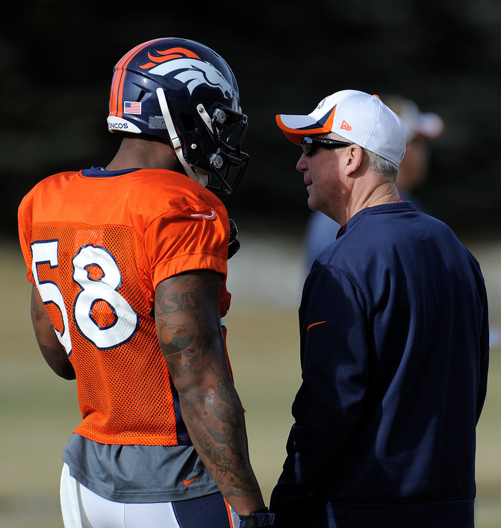 . Denver Broncos head coach John Fox talks with Von Miller (58) during practice December 18, 2013 at Dove Valley (Photo by John Leyba/The Denver Post)