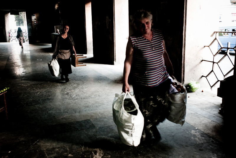 August 2011, Tbilisi, Georgia:  Women walk with their shopping bags in a market area in Tbilisi.  The new oil money has brought in a divide between the rich and the poor.   Since the flow of money has poured into Baku thanks to the Baku Tbilisi Ceyhan (BTC) oil pipeline.