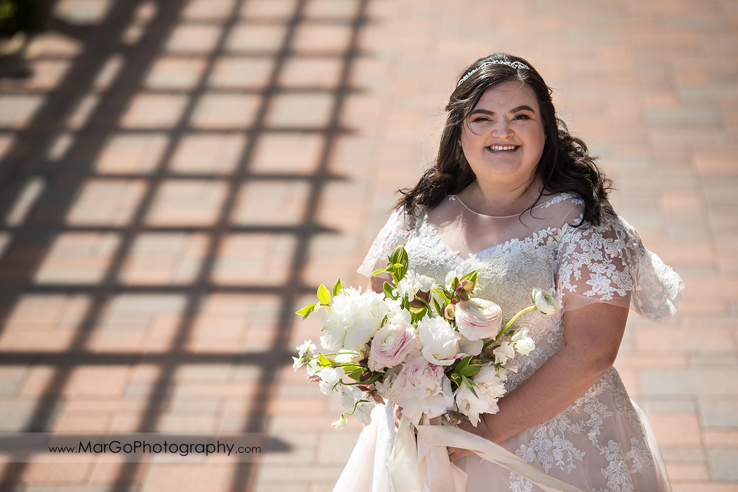 portrait of the bride with white flower bouquet at Livermore Garre Vineyard and Winery