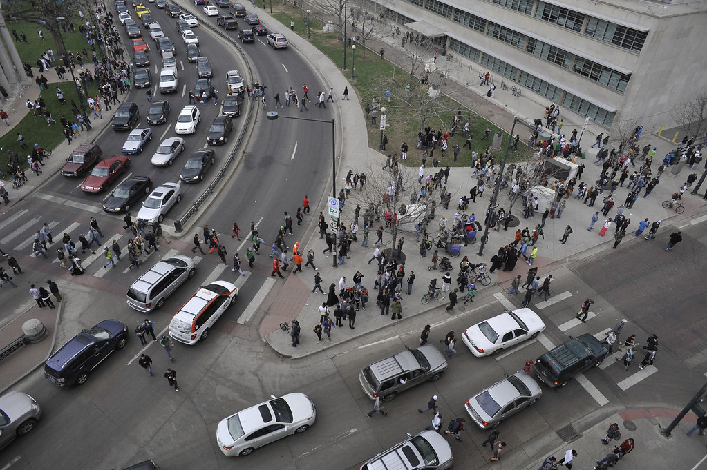 . DENVER, CO. - APRIL 20: 420 rally attendees flee Civic Center Park after shots were fired around 5 p.m. in Denver, Colorado. (Photo By Patrick Traylor/The Denver Post)