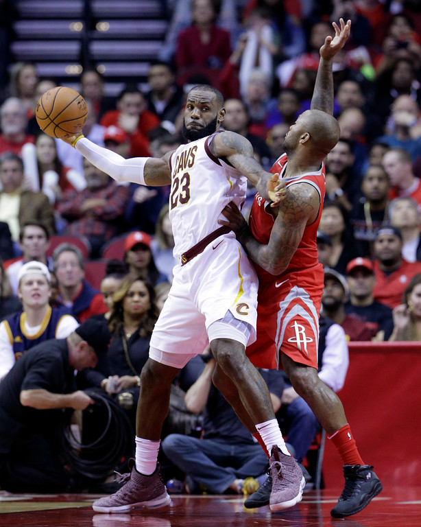 . Cleveland Cavaliers forward LeBron James (23) looks to pass under pressure from Houston Rockets forward PJ Tucker (4) during the second half of an NBA basketball game Thursday, Nov. 9, 2017, in Houston. (AP Photo/Michael Wyke)