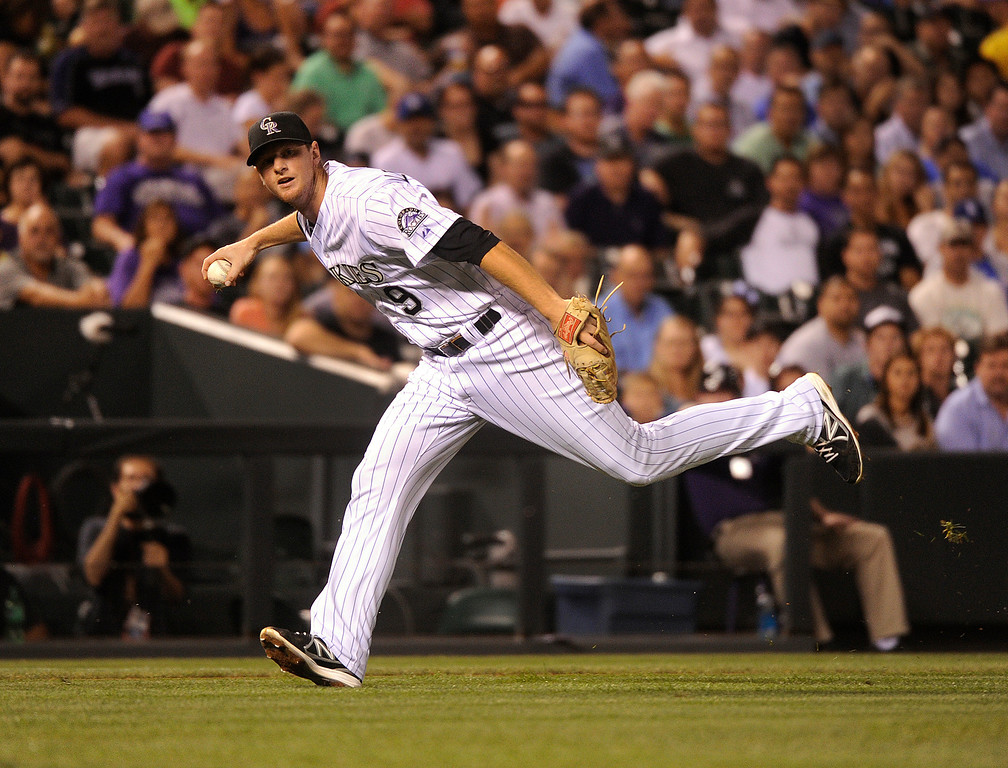 . DENVER, CO. - SEPTEMBER 4: Colorado infielder DJ LeMahieu had nowhere to throw on an infield hit by LA batter Michael Young in the sixth inning. The Colorado Rockies hosted the Los Angeles Dodgers at Coors Field Wednesday night, September 4, 2013.  Photo By Karl Gehring/The Denver Post