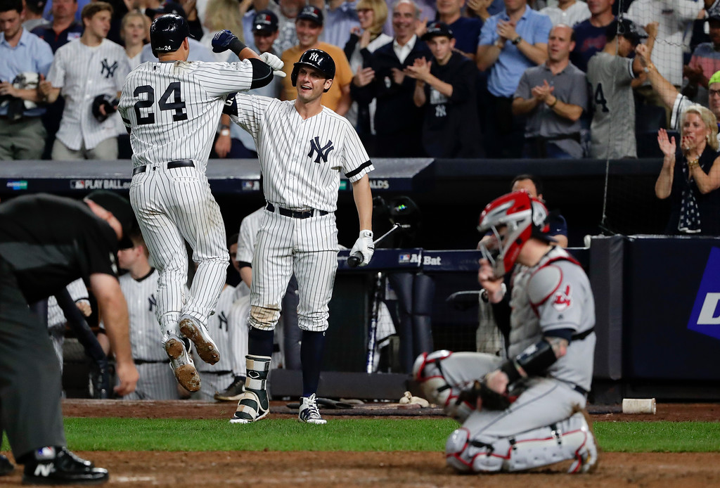 . New York Yankees\' Gary Sanchez (24) celebrates with Greg Bird after hitting a solo home run against the Cleveland Indians during the sixth inning in Game 4 of baseball\'s American League Division Series, Monday, Oct. 9, 2017, in New York.(AP Photo/Frank Franklin II)