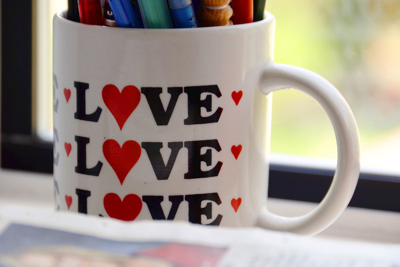 2012-6-4 ––– I saw all these colorful pens and pencils sticking out of this mug and thought it would make a nice image. I composed the shot to only reference all the colors in the mug and focus on the message – Love.