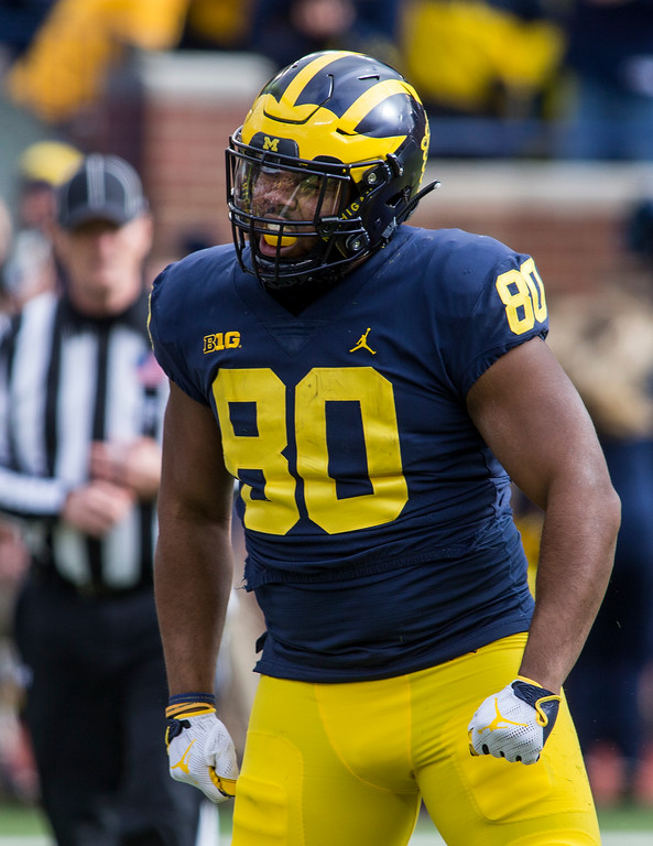 . Michigan fullback Khalid Hill (80) celebrates his touchdown in the first quarter of an NCAA college football game against Ohio State in Ann Arbor, Mich., Saturday, Nov. 25, 2017. (AP Photo/Tony Ding)