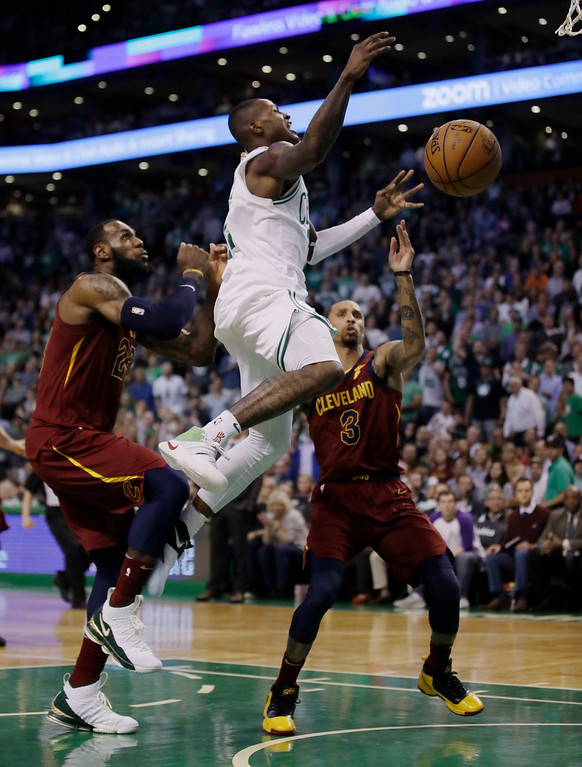 . Boston Celtics guard Terry Rozier, center, loses the ball as he drives against Cleveland Cavaliers forward LeBron James, left, and guard George Hill during the second half in Game 2 of the NBA basketball Eastern Conference finals, Tuesday, May 15, 2018, in Boston. (AP Photo/Charles Krupa)