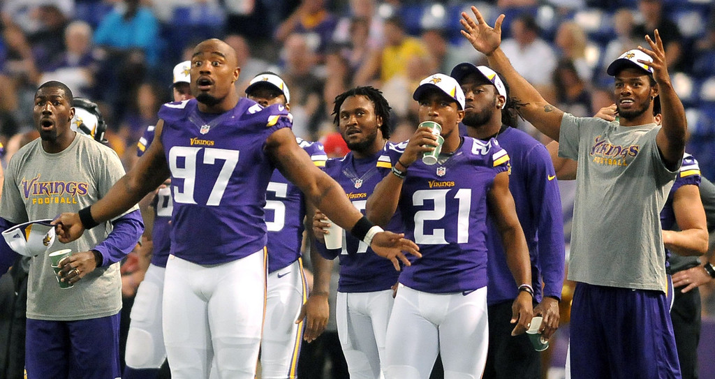 . Vikings defensive end Everson Griffen, left, and teammates react to a call on the field during the first half against the Titans.  (Pioneer Press: Sherri LaRose-Chiglo)