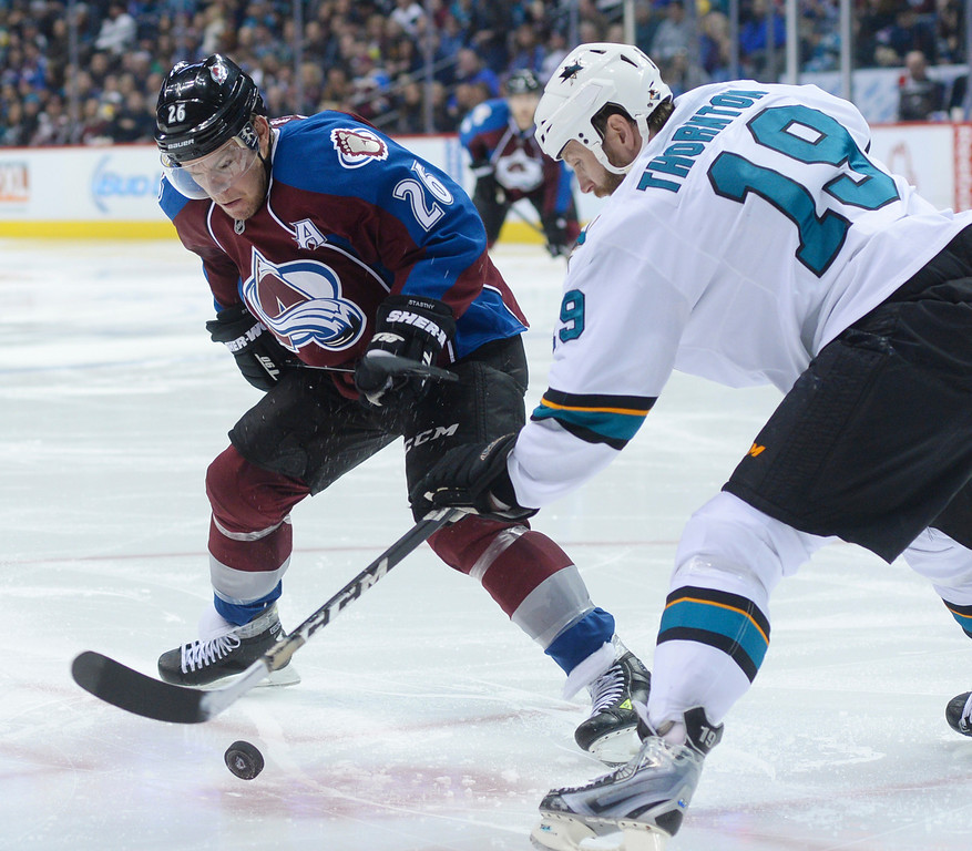 . DENVER, CO. - JANUARY 04:  Colorado center Paul Stastny faced off against Sharks center Joe Thornton in the third period. The Colorado Avalanche defeated the San Jose Sharks 4-3 at the Pepsi Center Saturday afternoon, January 4, 2014. Photo By Karl Gehring/The Denver Post