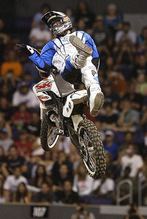 . The 10th X Games at the Staples Center in Los Angeles Thursday August 5,2004. Chuck Carothers of Kingwood, Teaxas win the gold with a score of 93:20 in the Moto X Best Trick.