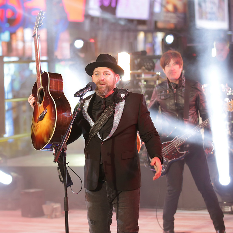 . Kristian Bush, of Sugarland, performs on stage at the New Year\'s Eve celebration in Times Square on Sunday, Dec. 31, 2017, in New York. (Photo by Brent N. Clarke/Invision/AP)