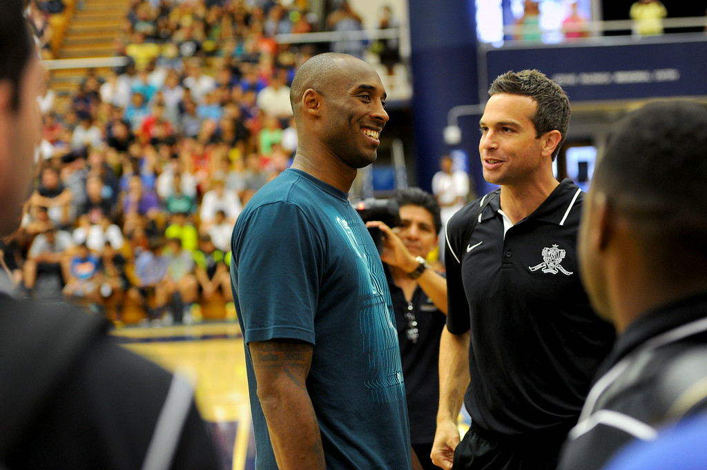 . Kobe Bryant talks with Doug Young, a former teammate from Lower Merion High School, and current instructor at the Kobe Basketball Academy at UCSB, Wednesday, July 9, 2014. (Photo by Michael Owen Baker/Los Angeles Daily News)