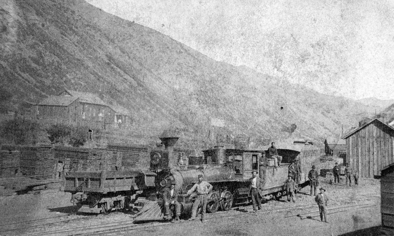 Bingham Depot. This is a very early photo of the railroad in Bingham, taken between December 1873, when the railroad was completed to Bingham, and June 1890, when the tracks were converted from narrow-gauge (3 feet) to standard gauge. (C. W. Carter Photo no. 939)