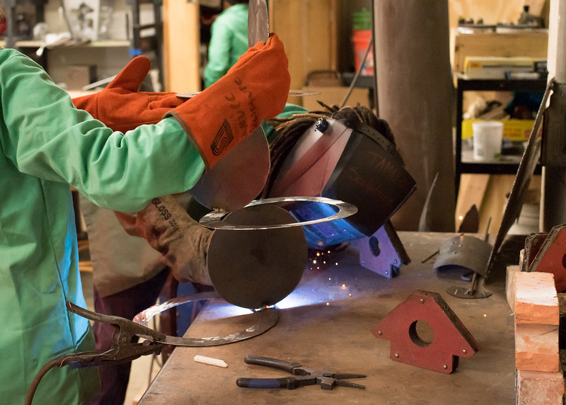 Student Josh Williams welds together his sculpture during Intermediate Sculpture.