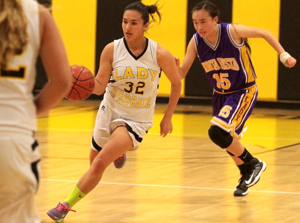 . Watsonville High forward Sonya Cervantes brings the ball up court for the Wildcatz with Monta Vista\'s Jackie Yee in pursuit in their Central Coast Section Division I playoffs game in Watsonville, Calif., on Feb. 19, 2013. Monta Vista won the first-round game 54-49. (Shmuel Thaler/Sentinel)