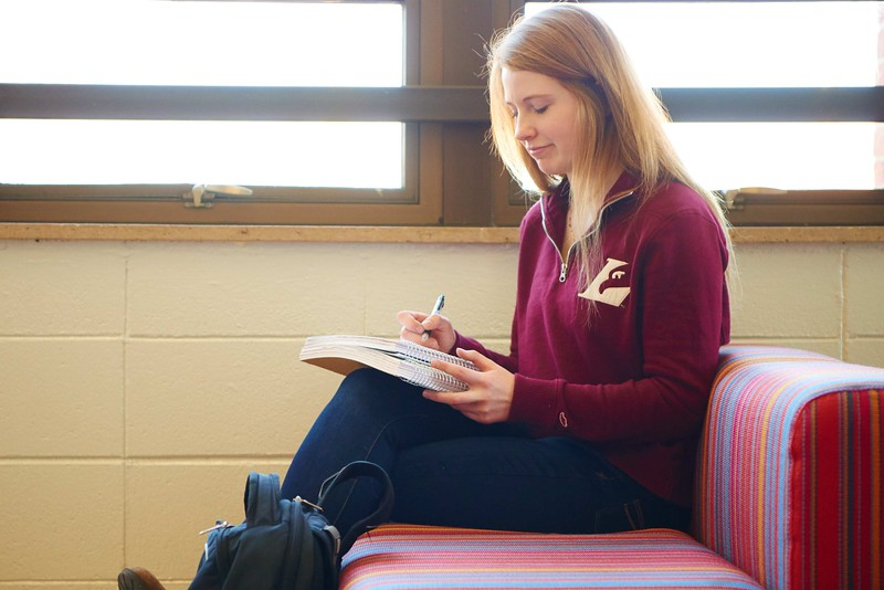 -UWL UW-L UW-La Crosse University of Wisconsin-La Crosse; Candid; Couch; day; December; Eagle L; Graff Main Hall; Inside; Notepad; Pen; Pencil; Student students; Studying; Woman women