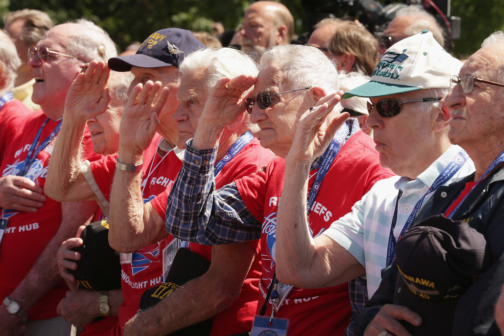 . American World War II veterans from Rhode Island participate in the 70th anniversary D-Day commemoration at the WWII Memorial on the National Mall June 6, 2014 in Washington, DC. Dozens of WWII veterans participated in the ceremony commemorating the invasion of Normandy by allied troops that turned the tide of the war.  (Photo by Chip Somodevilla/Getty Images)