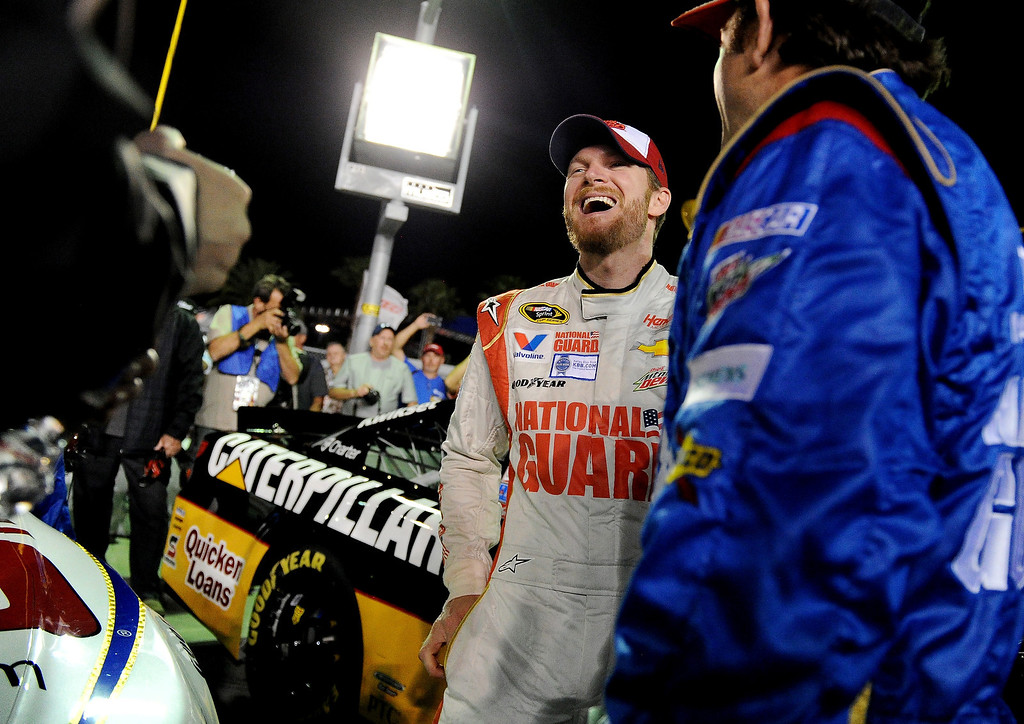 . Dale Earnhardt Jr., driver of the #88 National Guard Chevrolet, takes part in pre-race ceremonies for the NASCAR Sprint Cup Series Budweiser Duel 1 at Daytona International Speedway on February 20, 2014 in Daytona Beach, Florida.  (Photo by Patrick Smith/Getty Images)