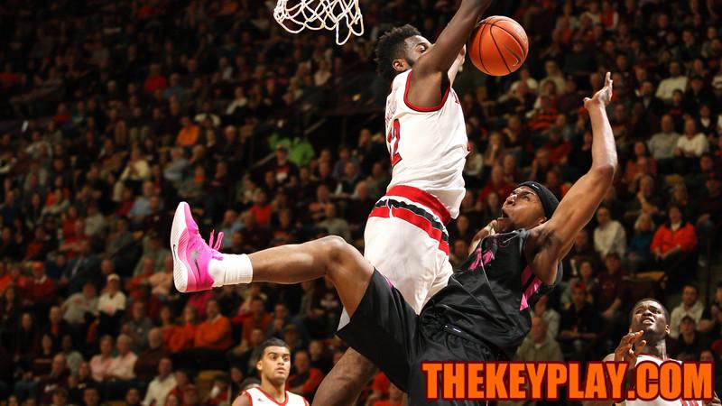 Zach Leday is fouled by Louisville's Chinanu Onuaku on a layup attempt. (Mark Umansky/TheKeyPlay.com)